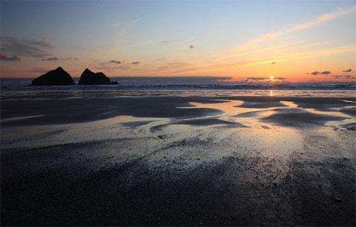 Sunset, beach and rock