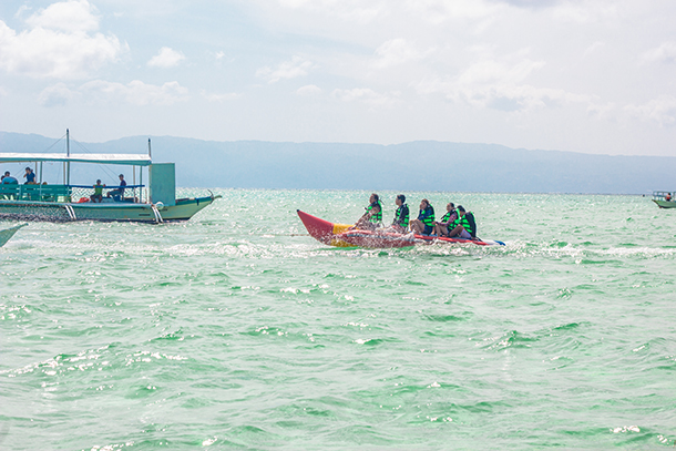 Manjuyod Sandbar Tour Package and Things To Do: Go on a Banana Boat Ride