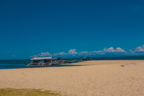 Bohol Island Hopping: Pumpboats at the Mocaboc's Sandbar