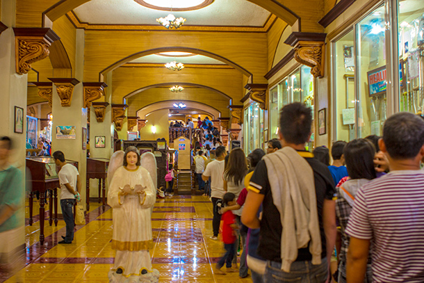 Line to the Mama Mary Statue at the Center of the Church