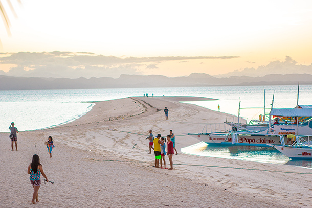 Why I Travelled Without my Daughter: Greeting the Sunrise at the sandbar in Kalanggaman Island
